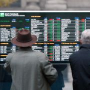 Men look at a stock exchange board monitor outside a bank, in Milan, Italy, Wednesday, Nov. 2, 2011. Antonio Calanni / TT NYHETSBYRÅN