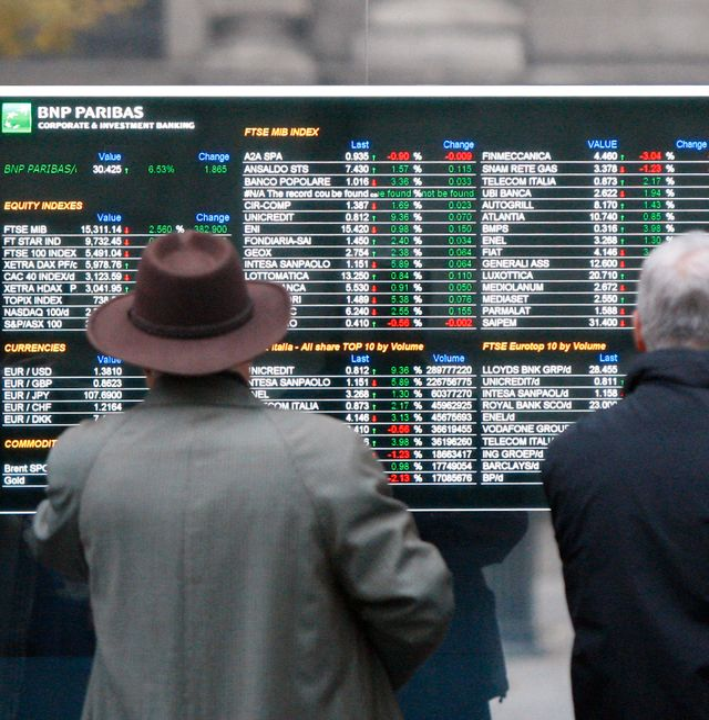 Men look at a stock exchange board monitor outside a bank, in Milan, Italy, Wednesday, Nov. 2, 2011. Antonio Calanni / TT NYHETSBYRÅN