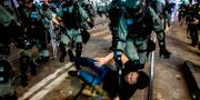 En demonstrant grips. ISAAC LAWRENCE / AFP