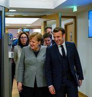 Tysklands Angela Merkel och Frankrikes Emmanuel Macron under förhandlingarna. POOL / TT NYHETSBYRÅN