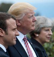 Emmanuel Macron, Donald Trump, Theresa May. STEPHANE DE SAKUTIN / AFP