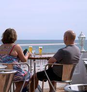 Ett par på en balkong i Algarve i Portugal.  Janerik Henriksson/TT / TT NYHETSBYRÅN