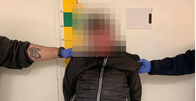 Den morddömda kvinnan efter att hon greps. Polisen