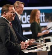 Stefan Löfven och Ulf Kristersson i samband med kvällens partiledardebatt. TT