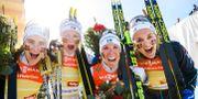 Ebba Andersson, Frida Karlsson, Charlotte Kalla och Stina Nilsson jublar. JOEL MARKLUND / BILDBYRÅN