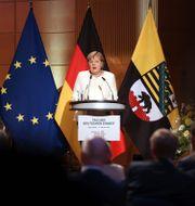 Angela Merkel under talet i Halle. Jan Woitas / TT NYHETSBYRÅN