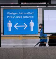 Man med munskydd. Janerik Henriksson/TT / TT NYHETSBYRÅN