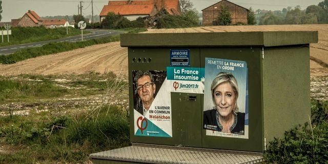 Valaffischer med Jean-Luc Mélenchon och Marine Le Pen. PHILIPPE HUGUEN / AFP