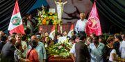 Garcíaanhängare vid begravningen. ERNESTO BENAVIDES / AFP