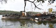 En större båt som ligger förtöjd i Årstaviken brann i somras. Henrik Montgomery/TT / TT NYHETSBYRÅN