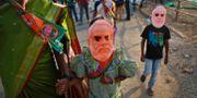 Barn i Narendra Modi-masker.  Rafiq Maqbool / TT NYHETSBYRÅN/ NTB Scanpix