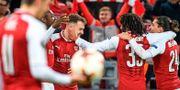 Arsenal firar efter segern i kvartsfinalen. ALEXANDER NEMENOV / AFP