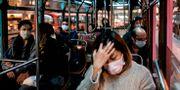 Pendlare i Hongkong i veckan. ANTHONY WALLACE / TT NYHETSBYRÅN