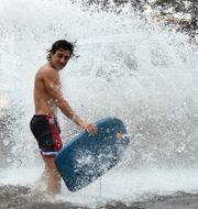 Australiens östkust har drabbats hårt av tung nederbörd. TT