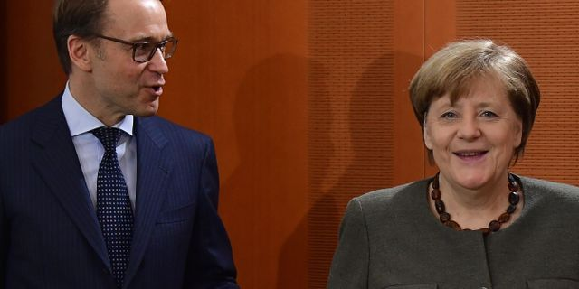 Weidmann och Merkel. Arkivbild. TOBIAS SCHWARZ / AFP