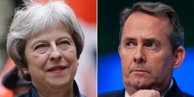Premiärminister Theresa May och handelsminister Liam Fox.  TT