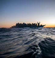 Migranter. Arkivbild. Bruno Thevenin / TT NYHETSBYRÅN