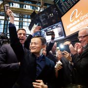 In this Sept. 19, 2014 file photo, Alibaba founder Jack Ma, center, raises a ceremonial mallet before striking a bell during the company's IPO at the New York Stock Exchange, in New York.  Mark Lennihan / TT NYHETSBYRÅN