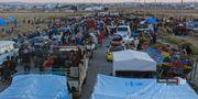 Människor på flykt från staden Daraa. TT / NTB Scanpix