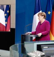 Emmanuel Macron och Angela Merkel. KAY NIETFELD / TT NYHETSBYRÅN