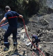 Brandmän i södra Frankrike. SYLVAIN THOMAS / AFP