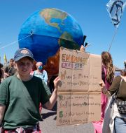 Demonstranter vid G7-mötet. Alastair Grant / TT NYHETSBYRÅN