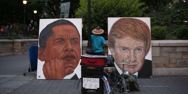 Målningar av Barack Obama och Donald Trump i New York. Stephen Yang / GETTY IMAGES NORTH AMERICA
