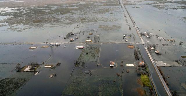 Översvämningar i spåren av Laura Gerald Herbert / TT NYHETSBYRÅN
