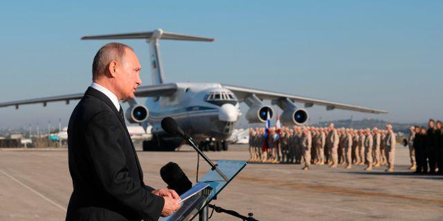 Vladimir Putin vid ett besök på en militärbas i Syrien, 2018. Mikhail Klimentyev / TT / NTB Scanpix