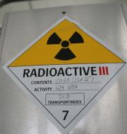 Skylt som varnar för radioaktivitet i radioaktivt avfall.  Fredrik Sandberg / TT / TT NYHETSBYRÅN