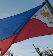 Filippinernas flagga.  Aaron Favila / TT NYHETSBYRÅN