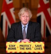Boris Johnson på måndagens pressträff. Leon Neal / TT NYHETSBYRÅN