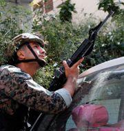 Säkerhetsstyrkor i Beirut. Hussein Malla / TT NYHETSBYRÅN