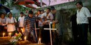Begravning för ett av offren. Gemunu Amarasinghe / TT NYHETSBYRÅN