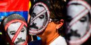 Människor från Venezuela som bor i Argentina protesterar mot Maduro. RONALDO SCHEMIDT / AFP