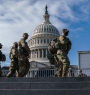 Soldater framför Kapitolium i söndags. J. Scott Applewhite / TT NYHETSBYRÅN