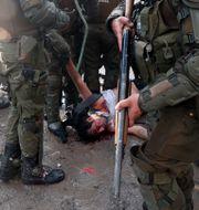Bild från protesterna i november förra året Esteban Felix / TT NYHETSBYRÅN