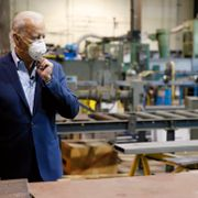 In this July 9, 2020, file photo Democratic presidential candidate, former Vice President Joe Biden adjusts his mask during a tour of McGregor Industries, a metal fabricating facility in Dunmore, Pa. Matt Slocum / TT NYHETSBYRÅN