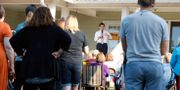 Buttigieg håller politisk möte på en veranda i Iowa. Charlie Neibergall / TT NYHETSBYRÅN