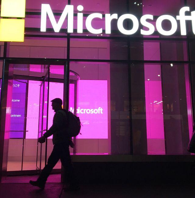 In this Nov. 10, 2016, file photo, people walk near a Microsoft office in New York. Swayne B. Hall / TT NYHETSBYRÅN