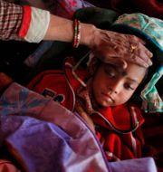 Sjukt barn i Nepal. Illustrationsbild. Niranjan Shrestha / TT NYHETSBYRÅN