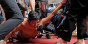 Polis griper en demonstrant i Hongkong. Kin Cheung / TT NYHETSBYRÅN