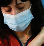 Vårdarbetare i Avellaneda får vaccinet.  Natacha Pisarenko / TT NYHETSBYRÅN