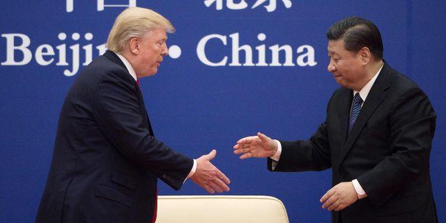 Trump och Xi under ett möte i Peking i november 2017.  NICOLAS ASFOURI / AFP