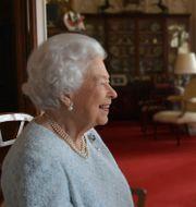 Drottning Elizabeth i videomöte. Buckingham Palace / TT NYHETSBYRÅN