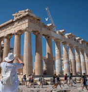 Turister vid Akropolis.  Petros Giannakouris / TT NYHETSBYRÅN