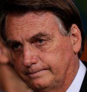 Allt fler vill nu se president Jair Bolsonaros avgång i Brasilien. Eraldo Peres / TT NYHETSBYRÅN