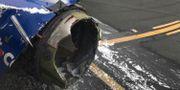 Foto av motorn taget av en person ombord på planet. Marty Martinez / TT NYHETSBYRÅN