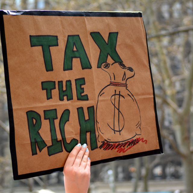Protestors call to tax the rich and impeach Governor Andrew Cuomo following allegations of sexual misconduct and a covering-up COVID-19 related nursing home deaths on March 20, 2021 in New York City. Shuttterstock