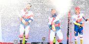 Fransmannen Mathieu Faivre, landsmannen Alexis Pinturault och slovenen Zan Kranjec på prispallen efter storslalomtävlingen under världscupen i Österrike. JOE KLAMAR / AFP